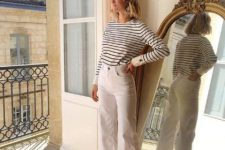 a Parisian fal outfit with a striped top, white jeans, dusty pink shoes is amazing for a warm day