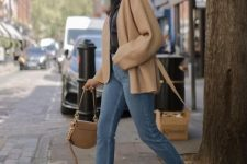 a black shirt, blue jeans, a tan cardigan, snake print moccasins and a tan bag to feel comfy