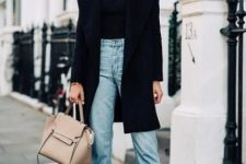 a black top, blue high waisted jeans, red shoes, a black coat and a nude bag to rock this fall