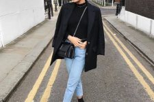 a black turtleneck, light blue cropped jeans, black sock boots, a black blazer and a black bag for the fall