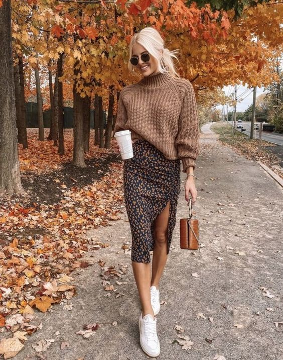 a brown chunky knit sweater with a turtleneck, a moody midi skirt with a slit, white sneakers and a bucket bag