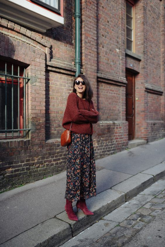 a burgundy chunky knit sweater, a dark floral midi, purple velvet sock boots and a brown ba