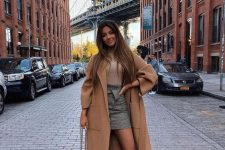 a camel turtleneck, a grey plaid mini, nude suede booties, a camel midi coat, a grey bag