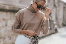 a camel turtleneck, a white A-line skirt, a snakeskin waist bag for a simple and cool fall look