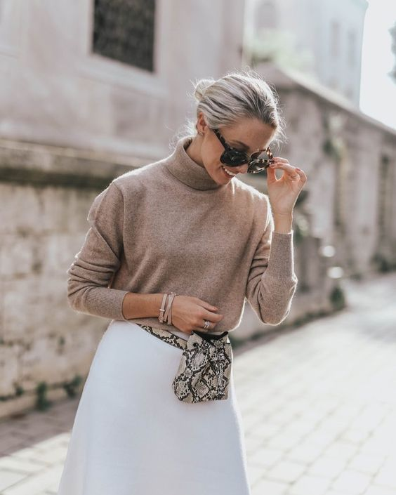 a camel turtleneck, a white A line skirt, a snakeskin waist bag for a simple and cool fall look