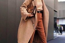 a camel turtleneck and a coat, rust-colored pants, leopard print booties and a brown bag