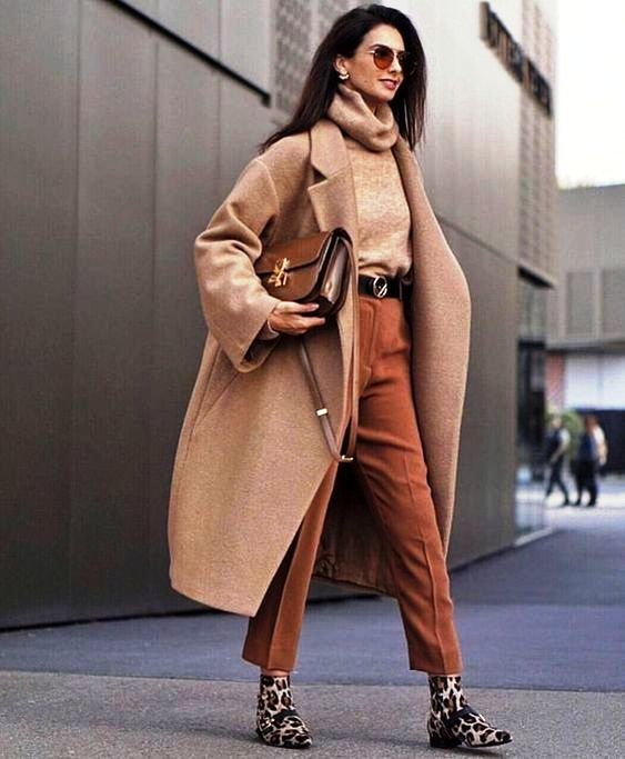 a camel turtleneck and a coat, rust colored pants, leopard print booties and a brown bag