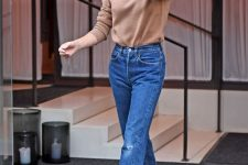 a camel turtleneck, blue ripped mom jeans, red heels for a cool and simple fall look