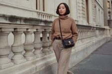 a camel turtleneck, grey pants, snakeskin booties and a black bag for a chilly day