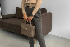 a camel turtleneck, grey pants, taupe boots and a taupe bag for a business casual look