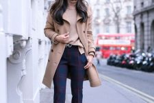 a camel turtleneck, navy and red plaid pants, navy shoes, a camel coat and a bag