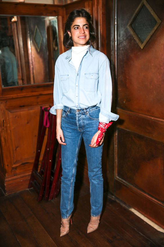 a chambray shirt, blue jeans, a white turtleneck, nude strappy shoes