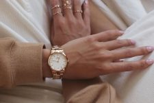 a copper bracelet watch and stacked copper rings create a soft and chic glow in your look
