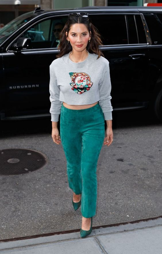 a creative look with a grey embroidered cropped sweatshirt, green suede pants, green heels