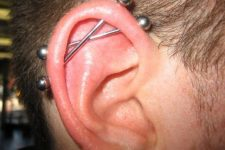 a double industrial piercing with matching jewelry for a bold statement and an edgy feel