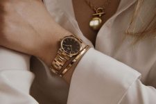 a gold round bracelet watch, a gold thin bracelet and a gold chain necklace for an ultimate touch