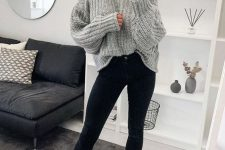 a grey chunky knit oversized sweater, black skinnies, white combat boots and a grey beanie
