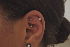a lobe, helix and rook piercing done with various silver and diamond studs