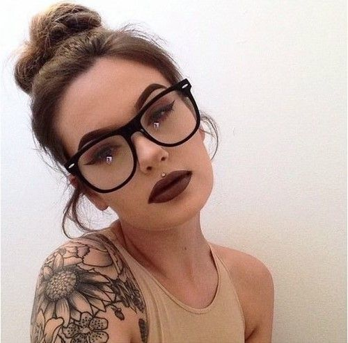 a medusa piercing, a dark lip and burgundy smokey eyes to make your look ultimately bold
