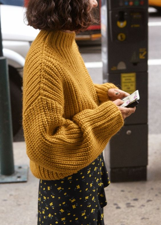 a mustard chunky knit sweater with a high collar, a black floral ruffle skirt for a fall look