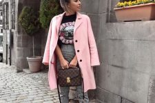 a printed black tee, plaid pants, a pink short coat, white sneakers and a brown printed bag