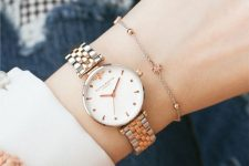 a refined combo with a mixed metal bracelet watch and a chain bracelet with copper beads is very girlish