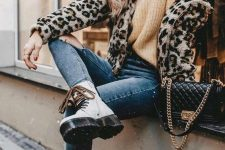 a sandy chunky sweater, blue skinnies, white combat boots, a leopard jacket and a black bag
