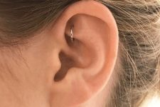 a single ear piercing – a rook one with a silver hoop is a stylish and minimalist idea to rock