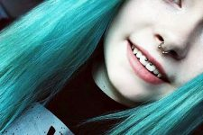 a smiley and nose piercing with matching barbell jewelry pieces for a bold look
