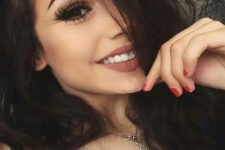 a smiley piercing done with a medical steel barbell jewelry piece and a nude lip