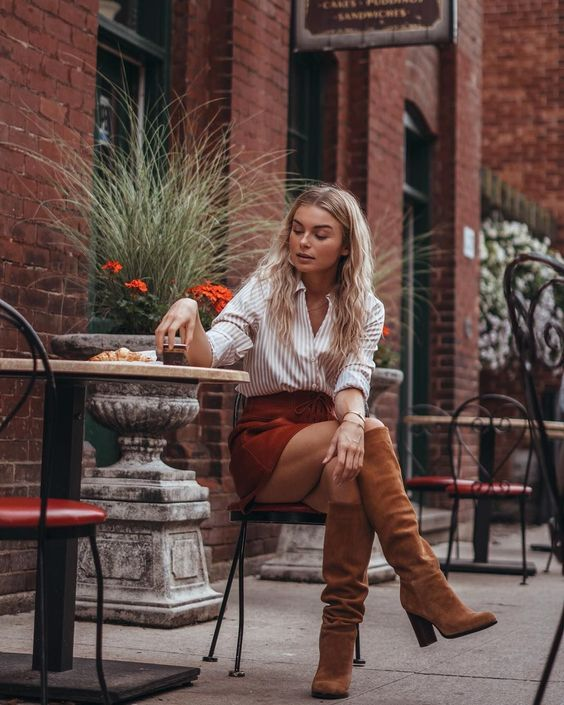 a striped shirt, a red suede mini, rust colored knee high boots for a chic fall look