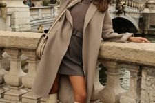 a stylish fall look with a grey turtleneck, a graphite grey mini skirt, creamy knee high boots, a tan coat and a neutral bag