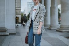 a stylish smart casual work look with a printed tee, a plaid oversized blazer, blue jeans, two tone slingbacks and a bucket bag