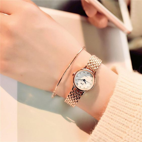 a super elegant combo   a thin copper bracelet and a matching watch with a chic bracelet for a minimal look