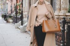 a tan turtleneck, a camel coat, black skinnies, brown moccasins and a brown bag