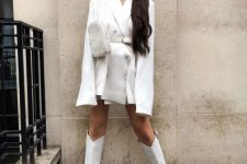a white blazer mini dress, a waist bag and white knee high boots for an ultimate fall look