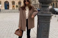 a white ribbed top, black skinnies, brown snakeskin boots, a taupe oversized blazer and a brown bag