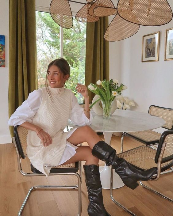 a white shirt, a creamy patterned overdress, black knee high boots for a statement