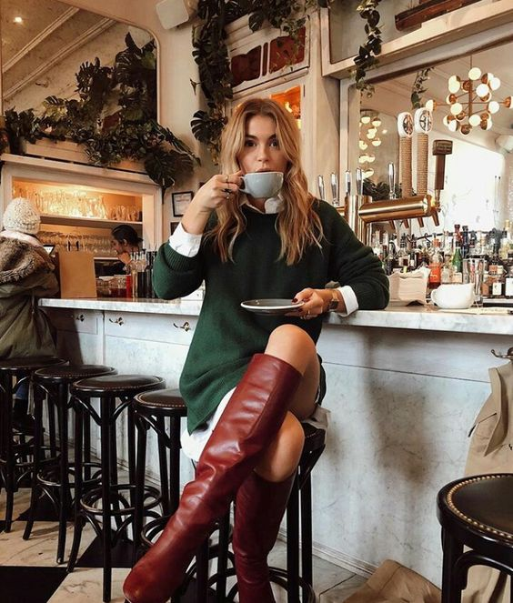 a white shirt a green sweater dress, burgundy knee high boots for a stylish fall look