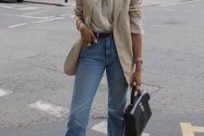 a white shirt with pockets, a tan oversized blazer, blue cropped jeans, square toe shoes and a black bag