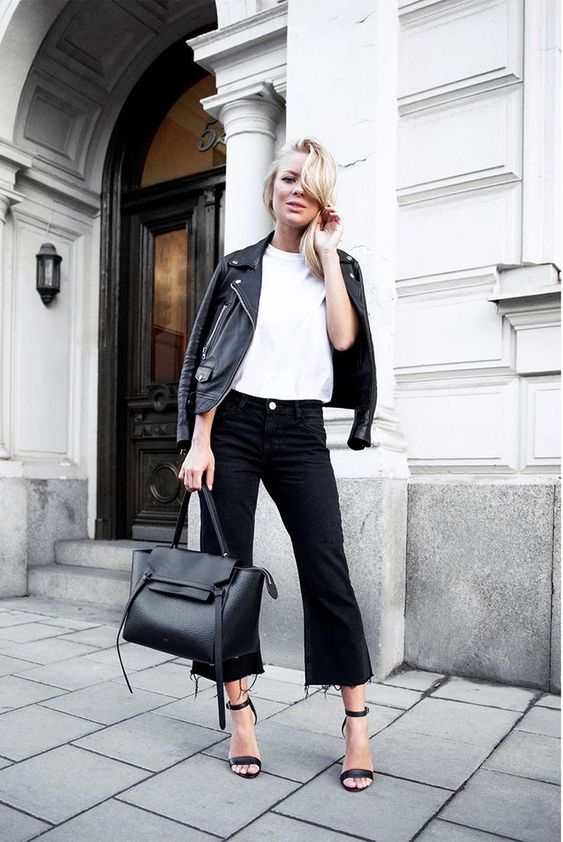 a white t-shirt, black flare jeans, black heels, a large bag and a black leather jacket for the fall