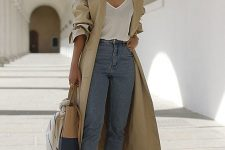 a white t-shirt, blue jeans, black mules, a neutral trench and a two tone bag to rock right now