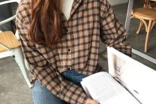 a white turtleneck, a plaid shirt and blue jeans for a trendy and casual look