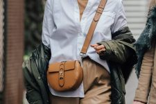 a camel turtleneck outfit with leather pants