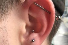 an anti tragus piercing plus an industrial one done with titan jewelry to match