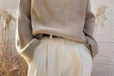 an elegant tan ribbed sweater, white pants and a belt for a stylish minimalist look