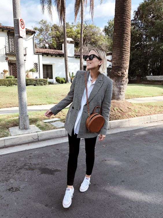 black skinnies, white sneakers, a white oversized shirt and an oversized plaid blazer plus a round bag