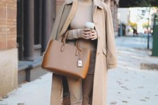 camel everything – a turtleneck, pants, a coat, flats and a brown bag for a work look