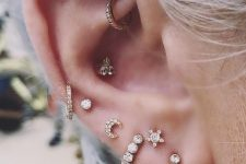 chic gold and diamond studs and hoops in the conch and rook, helix and lobe