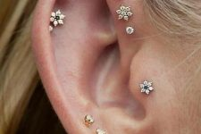 cool layered piercings – lobe, helix, flat, forward helix and tragus done with gold studs